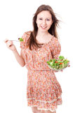 Happy young woman eating salad. Royalty Free Stock Image