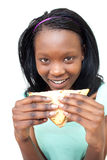 Happy young woman eating a sandwich Royalty Free Stock Photo