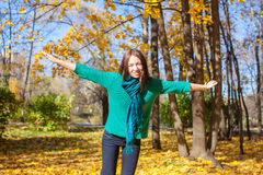 Happy young woman enjoy her autumn vacation in Royalty Free Stock Photo
