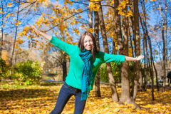 Happy young woman enjoy her autumn vacation in Royalty Free Stock Photography