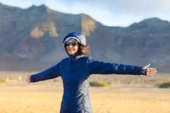 Happy young woman enjoy trip on mountains background royalty free stock images