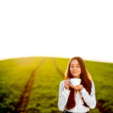 Happy young woman enjoying coffee Royalty Free Stock Image