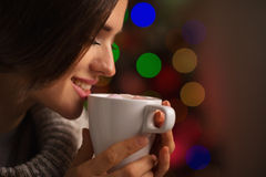 Happy young woman enjoying cup of hot beverage Royalty Free Stock Images