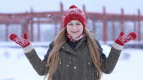 Happy young woman enjoying first snow stock video