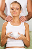 Happy young woman enjoying a massage. Face portrait Royalty Free Stock Photography