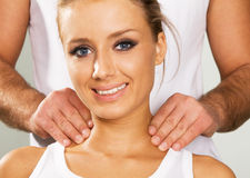 Happy young woman enjoying a massage Royalty Free Stock Photography