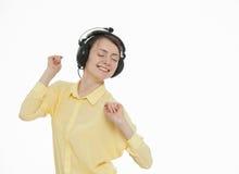 Happy young woman enjoying music Stock Photo