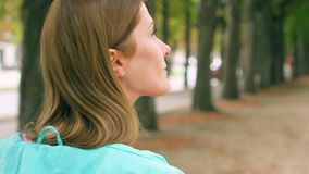 Woman enjoying nature relaxing outdoor. Walking in green park alone. Freedom loneliness concept stock footage