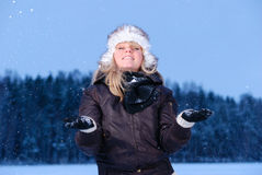Happy young woman is enjoying snow Royalty Free Stock Image