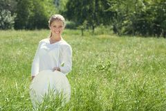 Happy Young Woman Enjoying Summer on the Green Meadow. Stock Image