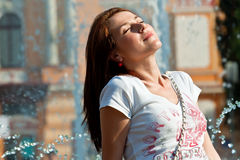 Happy young woman enjoying sun Stock Photos