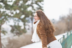 Happy young woman enjoying winter outdoors Royalty Free Stock Photo
