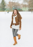 Happy young woman enjoying winter in park Royalty Free Stock Image