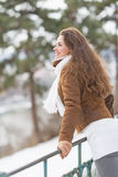 Happy young woman enjoying winter park Royalty Free Stock Photography