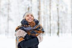 Happy Young Woman Enjoying Winter. Waist up portrait of happy young woman in winter forest having fun and enjoying snow, copy space stock image