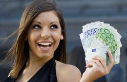 Happy young woman with Euro bills Stock Image