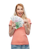 Happy young woman with euro cash money Stock Photo