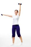 Happy young woman exercise with dumbbells Royalty Free Stock Images