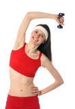 Happy young woman exercising with a dumbbell Stock Photography