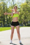 Happy young woman exercising outdoors Royalty Free Stock Images