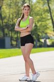 Happy young woman exercising outdoors Royalty Free Stock Image