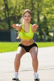 Happy young woman exercising outdoors Stock Photos