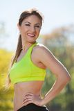Happy young woman exercising outdoors Royalty Free Stock Photography