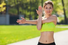Happy young woman exercising outdoors Stock Photo