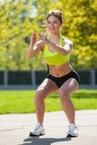 Happy young woman exercising outdoors Stock Images
