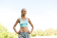 Happy young woman exercising outside Royalty Free Stock Images
