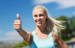 Happy young woman exercising outside Royalty Free Stock Photography