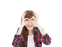 Happy young woman with eyes gesture Royalty Free Stock Photography