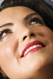 Happy young woman face looking up Royalty Free Stock Images