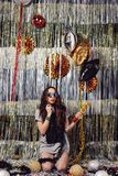 Portrait girl enjoying party and confetti. Happy young woman in fashionable clothes celebrating on a shimmer, colorful, party background. Party decorations gold stock photos