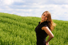 Happy young woman in a field. Stock Images