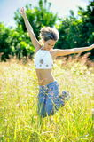 Happy young woman on field Royalty Free Stock Photo