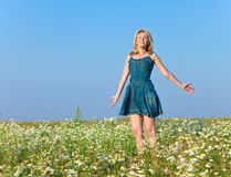 The happy young woman in the field Royalty Free Stock Photo