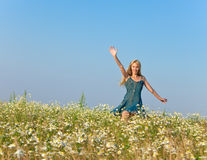 The happy young woman in the field of camomiles Royalty Free Stock Image