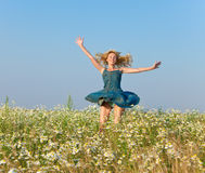 The happy young woman in the field of camomiles Royalty Free Stock Photography