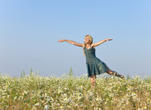 The happy young woman in the field  of camomiles Royalty Free Stock Photos