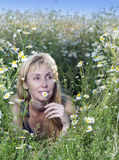 The happy young woman in the field  of camomiles Stock Photography