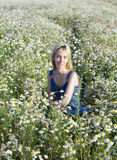 The happy young woman in the field  of camomiles Royalty Free Stock Images