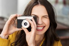 Happy young woman with film camera outdoors stock photos