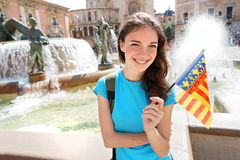 Happy young woman with flag of Valencian Community Stock Photos