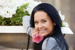 Happy young woman with a flower Stock Photos