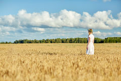 Happy young woman in flower wreath on cereal field Royalty Free Stock Photography