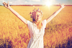 Happy young woman in flower wreath on cereal field Royalty Free Stock Photo
