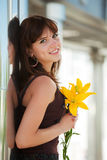 Happy young woman with a flowers Stock Image