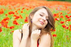 Happy young woman in flowers Royalty Free Stock Image