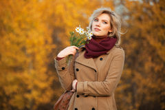 Happy young woman with a flowers Royalty Free Stock Image